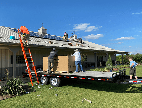 Comfortworks - a work crew installing solar panels for long-term energy independence on a pole barn in Jones, Oklahoma - Oklahoma Solar Pole Barn.